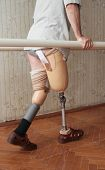 stock photo of prosthesis  - Male prosthesis wearer training in a special interior area  - JPG