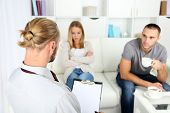 foto of not talking  - Unhappy couple not talking on couch at therapy session - JPG