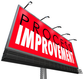 image of overhauling  - Process Improvement words on a billboard or sign ot illustrate an overhaul of outdated processes - JPG
