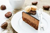 picture of truffle  - truffle cake with chestnut mousse on a white plate - JPG