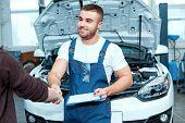 image of car repair shop  - Confident mechanic - JPG
