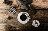 pic of cap gun  - American police officer morning donuts juice fresh black coffee and his gun - JPG
