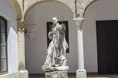 foto of carthusian  - Cartuja monastery courtyard with sculpture of a saint in the center Jerez de la Frontera C - JPG