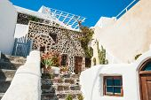 image of greek-architecture  - National Greek architecture terrace with flowers - JPG