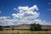 stock photo of southwest  - The American Southwest with mountains and high clouds - JPG