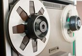 stock photo of magnetic tape  - silver reel with magnetic tape closeup in studio - JPG