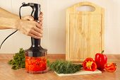 pic of blender  - Hands chefs mixed red pepper and tomato in a blender - JPG