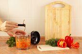 image of blender  - Hands chefs remove the knife blender after cooking vegetable mix - JPG