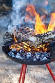 stock photo of slaughter  - Some pieces of fat on the barbecue - JPG