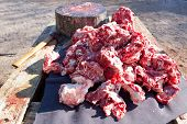 picture of slaughter  - Pieces of pig over wooden table - JPG