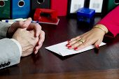 foto of white collar crime  - Woman offering a bribe in the envelope - JPG