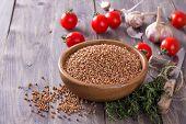 stock photo of buckwheat  - Buckwheat in a bowl with tomato - JPG