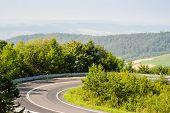 stock photo of twisty  - Serpentine road in mountains Bieszczady near Sanok Poland - JPG
