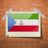 image of guinea  - Flags of Equatorial Guinea scotch taped to a red brick wall - JPG