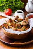 pic of chicken wings  - Fried chicken wings with sauces in wooden bowl top view - JPG