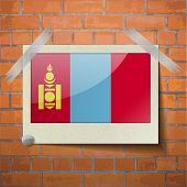 stock photo of mongol  - Flags of Mongolia scotch taped to a red brick wall - JPG