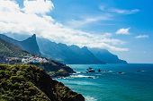 stock photo of atlantic ocean  - Coast or shore of Atlantic ocean with rock and blue sky with clouds and horizon in Tenerife Canary island Spain at spring or summer  - JPG