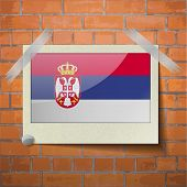 stock photo of serbia  - Flags of Serbia scotch taped to a red brick wall - JPG