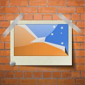 foto of tierra  - Flags of Tierra del Fuego Province scotch taped to a red brick wall - JPG