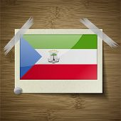 stock photo of guinea  - Flags of Equatorial Guinea at frame on wooden texture - JPG