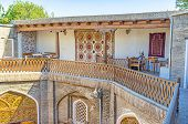 pic of caravan  - The terrace in old Caravan Saray is decorated with the silk carpets made in traditional style Bukhara Uzbekistan - JPG