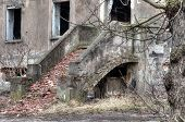 foto of homeless  - exterior stairs lead into left collapsing house the object falling into ruin is probably inhabited by homeless people - JPG
