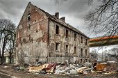 picture of homeless  - Left collapsing house the object falling into ruin is probably inhabited by homeless people - JPG