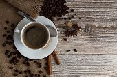 pic of scum  - Cup of coffee with spices standing on bleached board - JPG