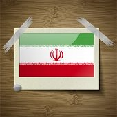 stock photo of tehran  - Flags of Iran at frame on wooden texture - JPG