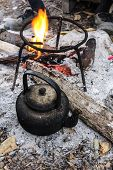 picture of kettles  - Old Kettle Boiling Water For Coffee Or Tea In Countryside In Thailand - JPG