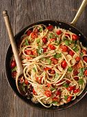 picture of cooked crab  - close up of rustic spicy italian crab and cherry tomato spaghetti pasta - JPG