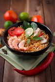 stock photo of thai cuisine  - Tom Yum Kung with noodles is popular Thai dish cuisine - JPG