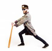 picture of queer  - Funny man dressed strangely holding a bat - JPG