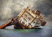 stock photo of shipwreck  - The sunken shipwreck on the reef Red Sea in Egypt - JPG