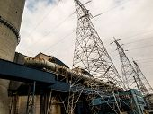 image of power transmission lines  - electrical power plant with high voltage transmission lines and pylons - JPG