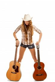 foto of cowgirls  - Sesy cowgirl in cowboy hat with a nylon string acoustic guitar - JPG