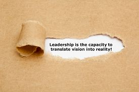 picture of leadership  - The quote Leadership is the capacity to translate vision into reality appearing behind torn brown paper - JPG