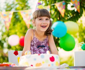 picture of birthday hat  - Happy pretty girl with cake at birthday party - JPG