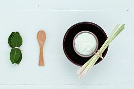 stock photo of scrubs  - asian homemade fresh herbs scrubs and skin care on wood background - JPG