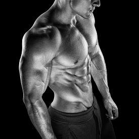 stock photo of packing  - Young athletic man torso showing six pack abs - JPG