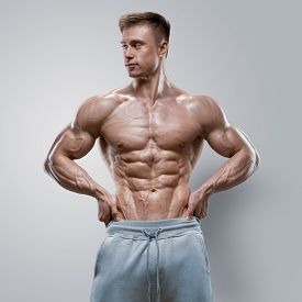 pic of bicep  - Handsome power athletic young man with great physique - JPG