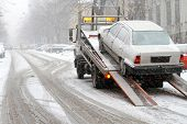 stock photo of towing  - Car break down and towing at snow street - JPG
