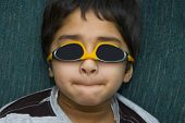 stock photo of rutin  - An young asian kid having fun with his goggles - JPG