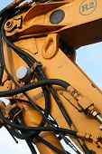 stock photo of jcb  - Hydraulic arm of a construction digger showing pipes and rams - JPG