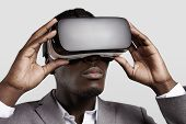 Постер, плакат: 3D Technology Virtual Reality Entertainment Cyberspace Concept Young Dark skinned Entrepreneur W