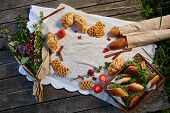 Picnic On A Green Lawn, Pastries And Vegetables On A Homespun Tablecloth, Summer Season, Flat Lay, S poster