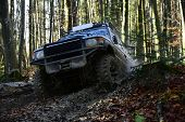 Sport Utility Vehicle Or Suv Overcomes Obstacles. Offroad Race On Fall Nature Background. Motor Raci poster