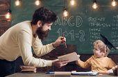 Teacher Concept. Teacher Read Book To Little School Boy. Teacher Man Teach Child In Class. It Is Tea poster
