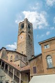 Clock Tower Campanone At Piazza Vecchia In The Old Town Of Bergamo. poster