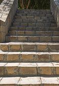 Closeup Detail Of Stone Paved Steps On Rural Footpath Walkway Going Upwards In Formal Garden Grounds poster